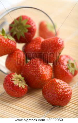 Ripe Strawberries Falling From Glass Bowl