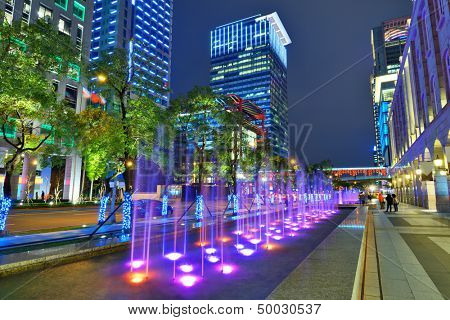 TAIPEI, TAIWAN - JANUARY 18: Fountains in the Xinyi District January 18, 2013 in Taipei, Taiwan. The district is the commercial and financial heart of the city.