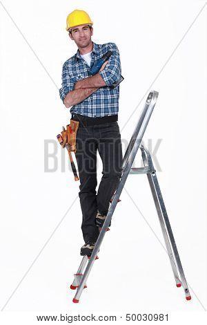 Tradesman standing on a stepladder