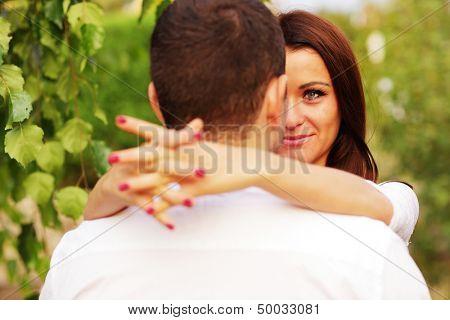 Closeup portrait of a romantic couple in the park
