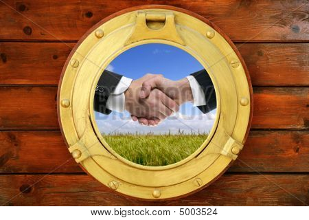 Businessmen Handshake View From Boat Round Window