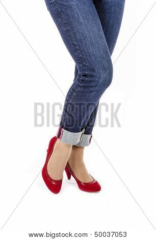 Woman Wearing Capri Blue Jeans and Red Suede Pumps