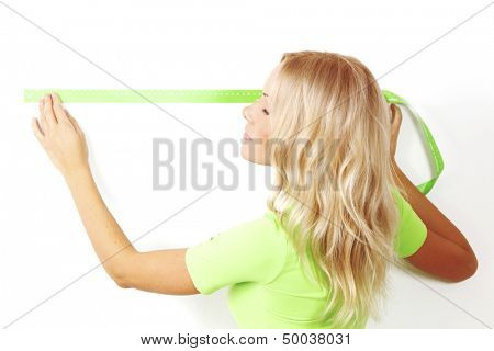 women often with a measuring tape to the wall