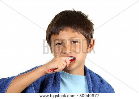 Young boy brushing teeth