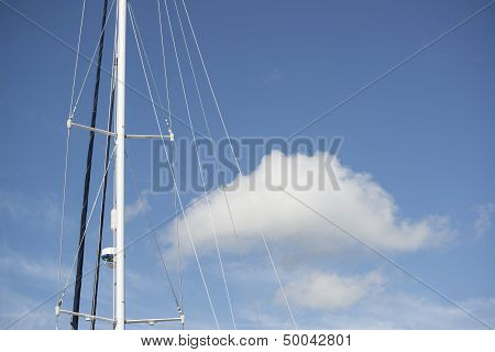 Blue Summer Sky Fluffy Cloud And Yacht Mast