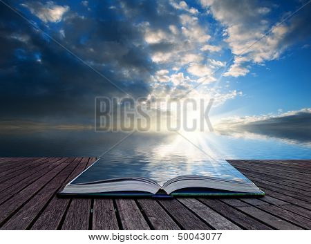 Creative Concept Pages Of Book Stunning Landscape At Sunset Reflected In Ocean