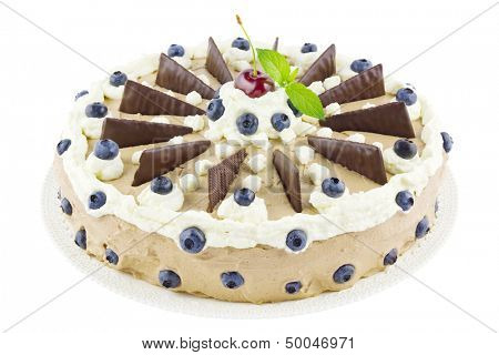 Big homemade mousse au chocolat or chocolate cream tart on a cake plate isolated on white