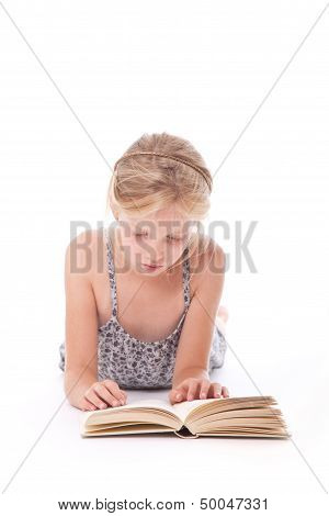 Young Girl Reading A Book Against White Background