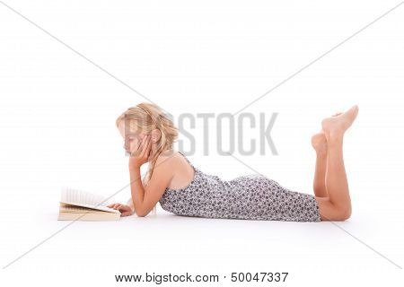 Young Girl Reads A Book Lying Down