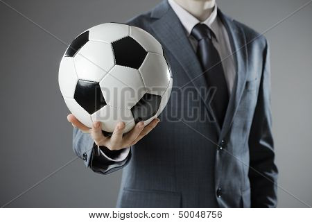 Elegant Businessman Holding A Soccer Ball