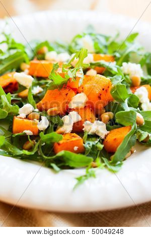 pumpkin salad with feta,arugula and pine nut