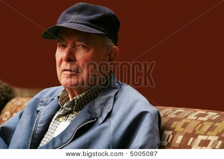 Senior Man Sitting In Waiting Room