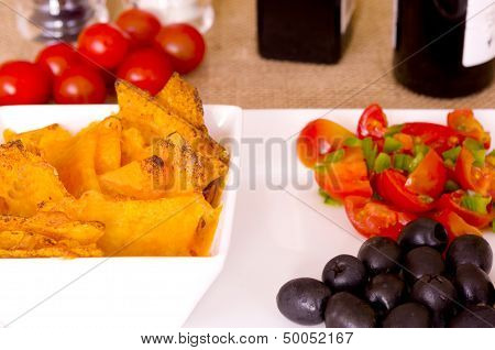 Nachos, Melted Cheese, Olives, Tomatoes and Peppers