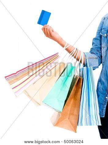 Woman shopping with a credit card - isolated over white background