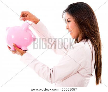 Business woman saving money in a piggybank - isolated over white