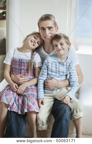 Portrait of children sitting on father's laps