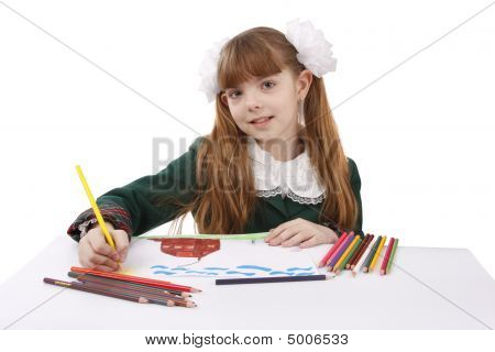 Girl Is Drawing  In Pencil.