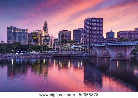 The skyline of downtown Hartford, Connecticut at dusk from across the Connecticut River.