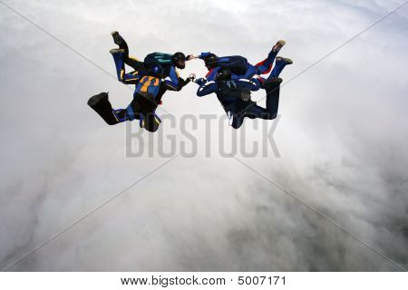 Four Skydivers Doing Formation