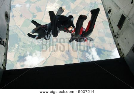 Four Skydivers Exits A Plane