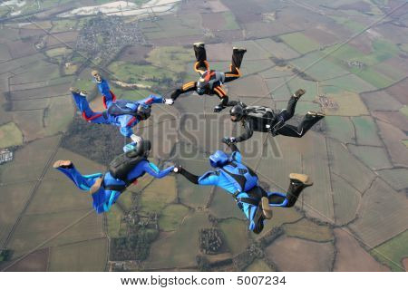 Five Skydivers In A Star Formation
