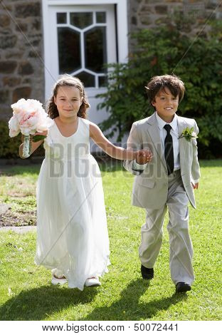 Portrait Of Bridesmaid With Page Boy