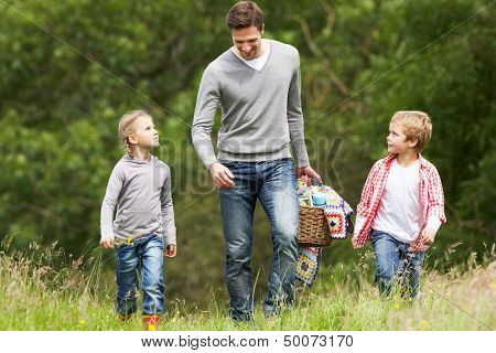Father Taking Children On Picnic In Countryside