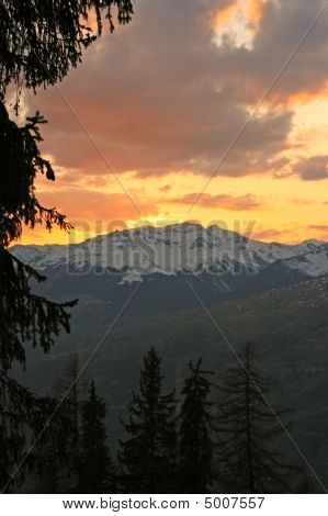 Sunset Over A Snow Covered Mountain