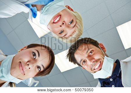 Dentist and dental team looking down during treatment on patient