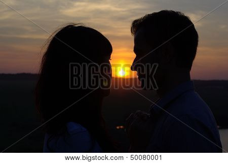 Silhouette of sweethearts at sunset