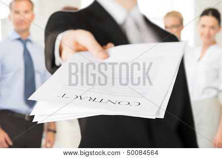 business concept - businessman with contract