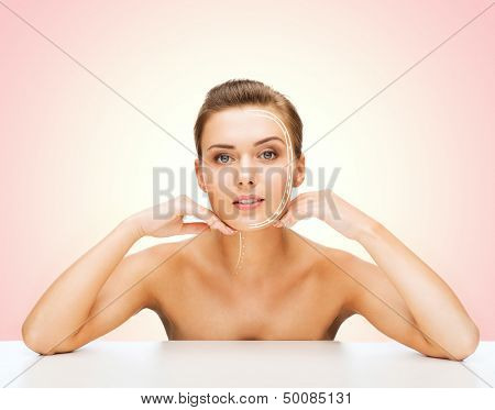 beauty and skin care concept - face of beautiful woman with lines