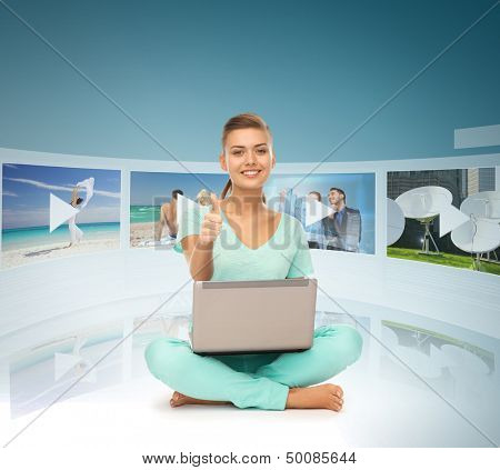 technology, internet, tv and news concept - young woman with laptop pc and virtual screens