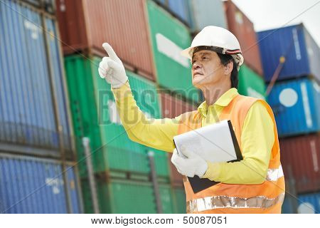 adult chinese terminal cargo dock warehouse worker in front of container