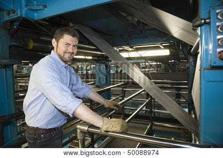 Portrait of a smart man working in newspaper factory