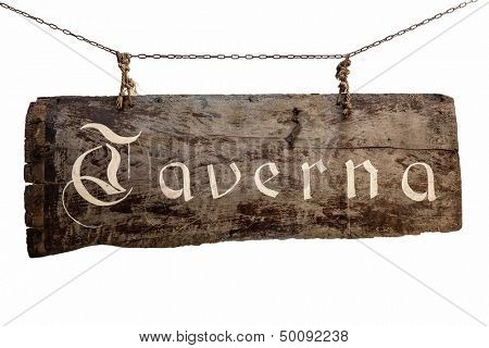 """The inscription on the old wooden sign """"Taverna"""" hanging on chains"""