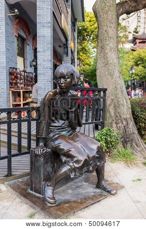 statue of ding ling (social activist and writer ) in pedestrian way of duolon road  at the city of Shanghai in China