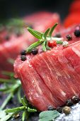 picture of peppercorns  - Raw beef steak with peppercorns and herbs - JPG