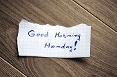 picture of wood pieces  - Good Morning Monday written on piece of paper on a wood background.