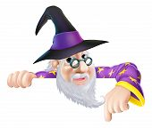 stock photo of warlock  - An illustration of a wizard cartoon character peeking over a sign or banner and pointing down - JPG