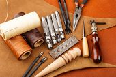 stock photo of leather tool  - Homemade leather craft tool and accessories - JPG