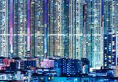 image of overpopulation  - Overpopulated modern building in Hong Kong at night - JPG