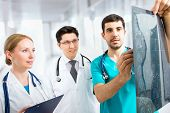 stock photo of radiogram  - Portrait of a smart young doctors works in a hospital - JPG