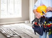 stock photo of hand tools  - Handyman with a tool belt - JPG