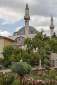 stock photo of rumi  - Tomb of Mevlana the founder of Mevlevi sufi dervish order with prominent green tower in Konya Turkey - JPG