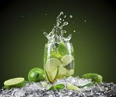 stock photo of cocktail  - Mojito cocktail with splash and ice - JPG
