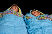 pic of sleeping bag  - Two young boys sleep in sleeping bags - JPG