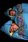 stock photo of sleeping bag  - Two young boys sleep in sleeping bags - JPG