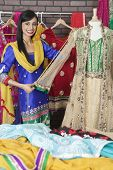 picture of dupatta  - Portrait of Indian designer measuring traditional outfit at design studio - JPG