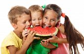 stock photo of melon  - Happy family eating watermelon - JPG